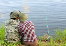 Two Fishers Are On A River Ban...