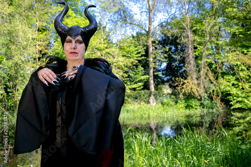 Evil fairy tale, maleficent, malevolent queen with horns and crow feather gown Tablou Canvas