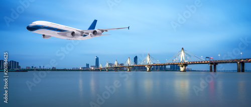 Airplane flying over tropical sea at beautiful sunset or sunrise scenery backgro Fototapet