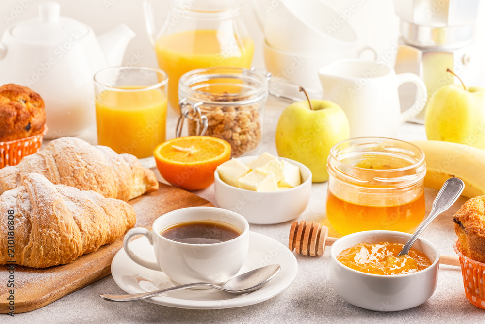 Fototapeta Continental breakfast with fresh croissants, orange juice and coffee