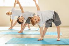 Little Children Practicing Yog...