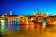 Zaragoza city, Spain, view over river to Cathedral at sunset