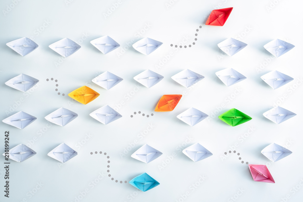 Fototapety, obrazy: Group of paper ships in one direction and with one group individual pointing in the different way. Business for Innovative solution Concept.