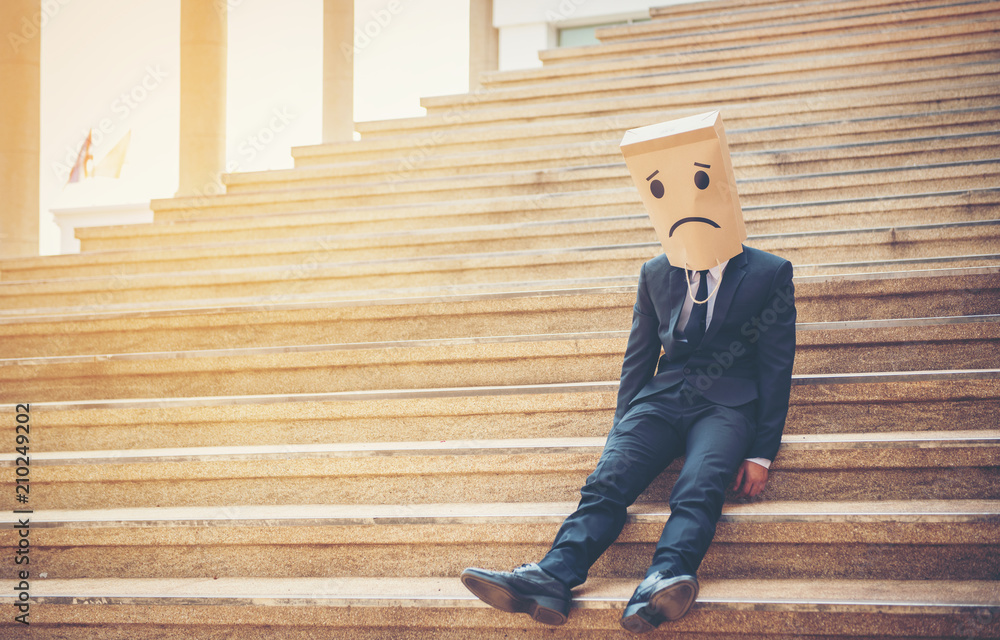 Fototapety, obrazy: Businessman masked stress on the company stairs.