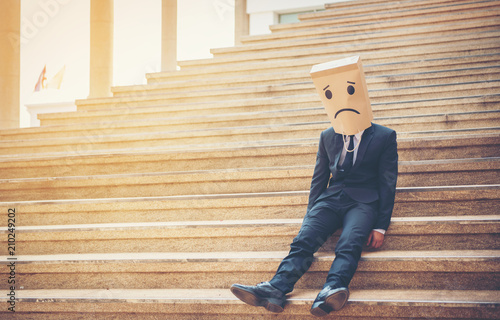 Businessman masked stress on the company stairs. Wallpaper Mural