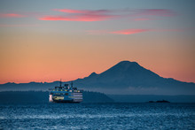 Bainbridge Island Ferry At Sunrise With Mount Rainier In The Distance
