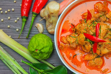 Red Curry Chicken, Thai Spicy Food And Fresh Herb Ingredients On Wooden Top View / Still Life, Selective Focus