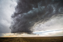 A Supercell Thunderstorm Towers Over The Landscape Of The Great Plains.