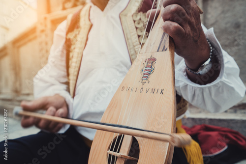 Man Plays Croatian Musical Instrument in Dubrovnik - 210263087