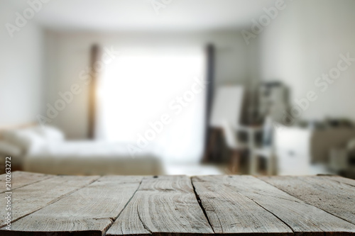 Fototapeta Wood top table with white blurred bathroom interior Background. for product display montage. obraz