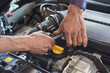 Auto mechanic hands with wrench repairing car. Selective focus.