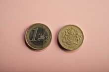 Coins One Euro, One Pound On A...