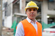 Handsome Persian man construction worker at the construction sit