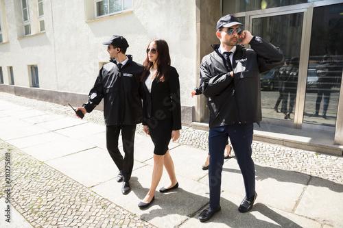 Fotografie, Obraz Young Businesswoman Walking On Sidewalk
