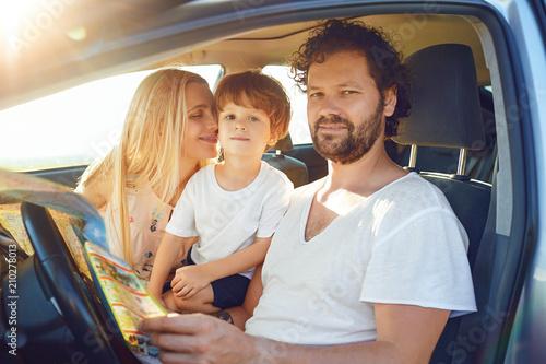 Fotografia, Obraz  The family travels in the car in the summer.