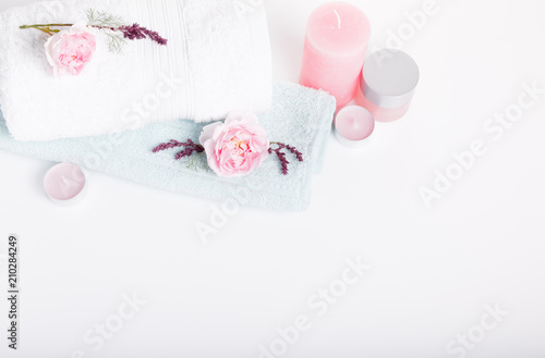 Keuken foto achterwand Spa Spa concept in Valentine's Day, Birthday Day, pink roses, candles, blue towels, flowers. Spring or summer background