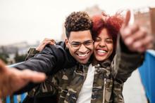 Cheerful Black Couple Embracin...