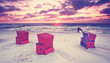 rote Strandkörbe am Ostseestrand