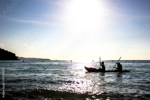 Garden Poster Shipwreck boating on the sea background, Boat with pople on sunset in water, silhouette of a tourist on a boat with sunset in the background