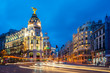 Car and traffic lights on Gran via street, main shopping street in Madrid at night. Spain, Europe. Lanmark in Madrid, Spain