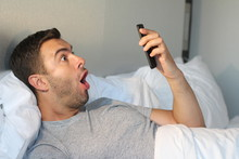 Shocked Man Reading Something On Cellphone