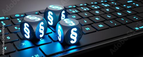 Photo Leuchtende Würfel mit Paragraphen-Symbol auf Tastatur