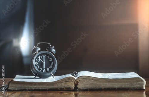 Clock on holy Bible in the morning, How much the time of man given to God,christian concept Tapéta, Fotótapéta