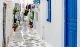 Fototapeta Uliczki - Narrow street with white houses, Greece