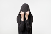 Woman Hiding Face Under The Cl...