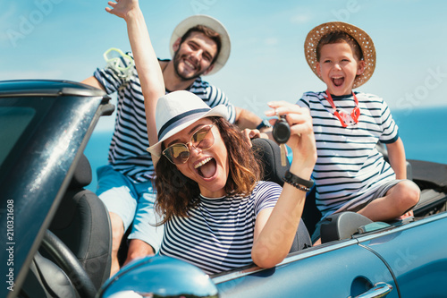 Poster Attraction parc Happy family travel by car to the sea. People having fun in cabriolet. Summer vacation concept
