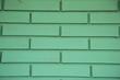 Grüne gemauerte Wand