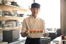 Chef Serving Sushi In A Restau...