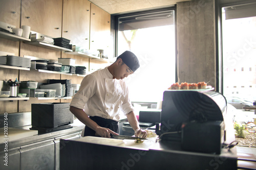 Chef preparing sushi in a Japanese restaurant