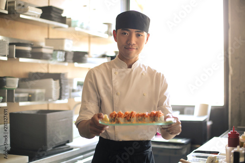 Chef serving sushi in a restaurant