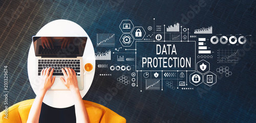 Papiers peints Kiev Data protection with person using a laptop on a white table
