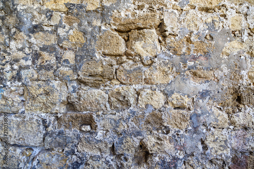 Foto op Plexiglas Wand texture of the ancient castle wall of stone and granite