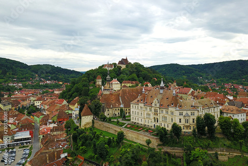 Fotografie, Obraz  Sighisoara aerial view with clock tower and medieval buildings