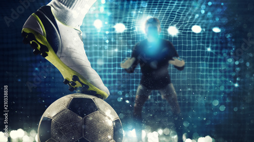 Fotomural  Close up of a soccer striker ready to kicks the ball in the football goal