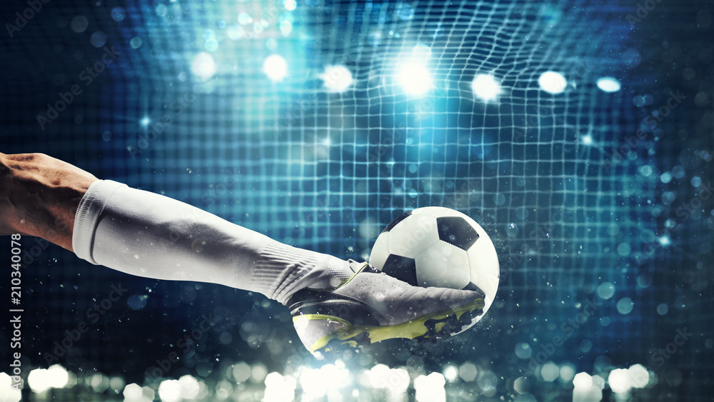 Fototapeta Close up of a soccer striker ready to kicks the ball in the football goal