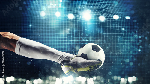 Fototapeta Close up of a soccer striker ready to kicks the ball in the football goal obraz