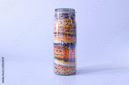 Valokuva  glass jar with colored croup and cereals