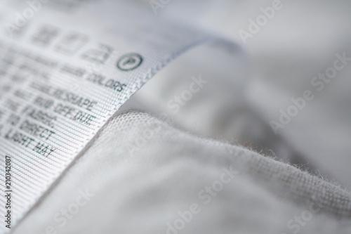 Obraz na plátne Cloth label tag with laundry care instructions