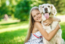 Little Girl With Golden Retriever Dog In The Park