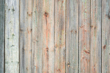A wooden background with the remains of paint.