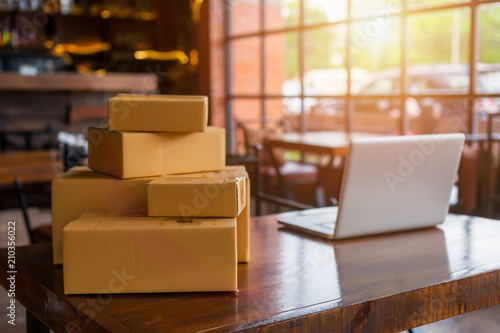 Packing accessories at workplace of startup small business owner, cardboard parcel box for online selling Canvas Print