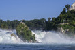 View of a powerful waterfall on the River Rhine in Switzerland, the beauty of Europe.