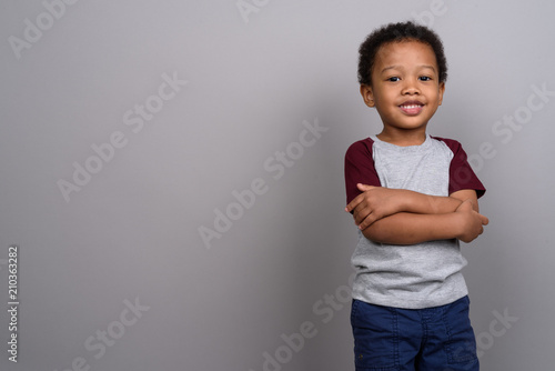 Fotografie, Obraz  Young cute African boy against gray background