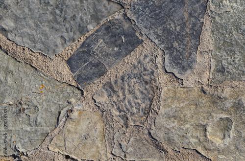 In de dag Stenen Gray texture of rough stone on the road