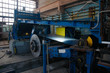 Manufacture of galvanized steel by rolling. Galvanized steel passes through coils. Roll of galvanized steel or metal on machine in industrial workshop on rolling mill, manufacturing metalwork factory