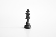 Black King Chess Piece In Whit...